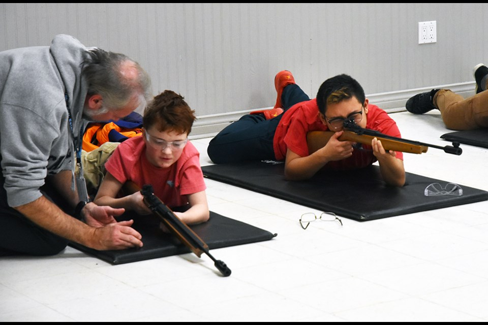 Load, pump, aim - Air Cadets with 37 Flight get help at rifle practice. Miriam King/Bradford Today