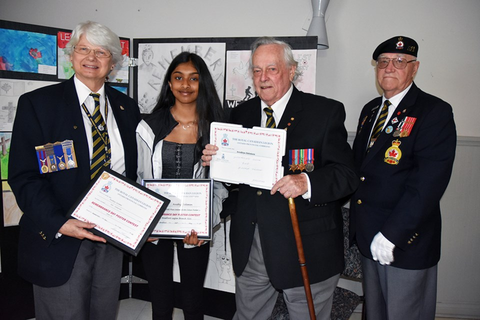 Avodhya Solomon's colour poster won 1st at the Bradford Branch of the Legion, 1st at Zone, and placed second provincially, at District. She is congratulated by the Legion's Ruth Brooks, veteran Les Buxton, Legion Sgt.-At-Arms George Neilson. Miriam King/Bradford Today