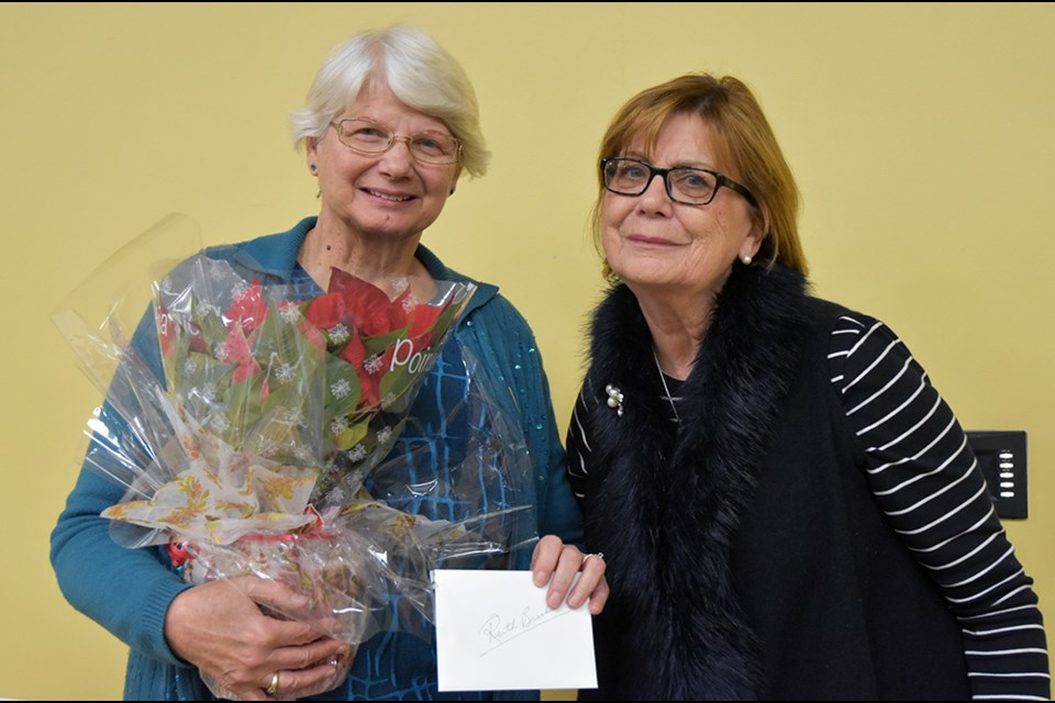 Speaker Ruth Brooks, left, is  thanked by BWG Local History Association member Mikki Nanowski. Miriam King/Bradford Today
