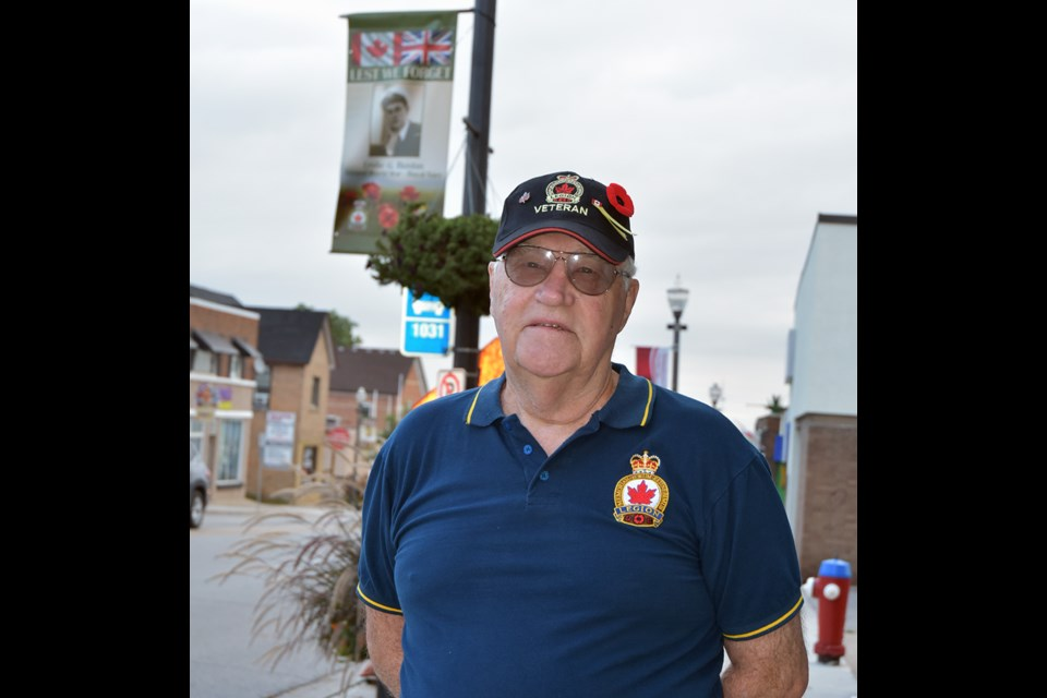 Veterans Service Officer George Neilson oversaw the hanging of the Veterans Banners.