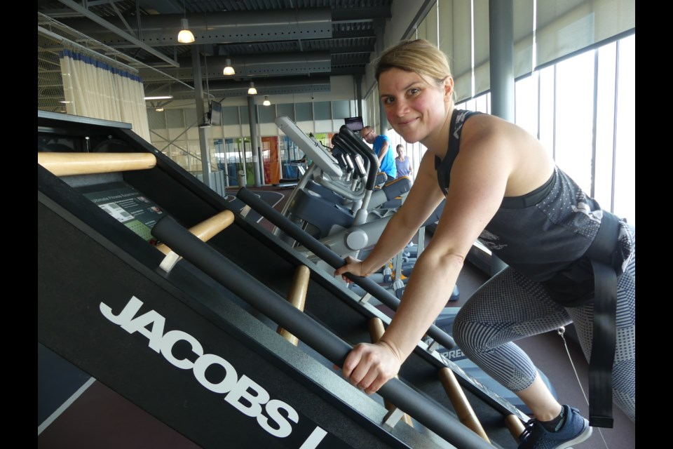 Stephanie Uren, fitness supervisor at the BWG Leisure Centre, demonstrates how to use the Jacobs Ladder. Jenni Dunning/BradfordToday