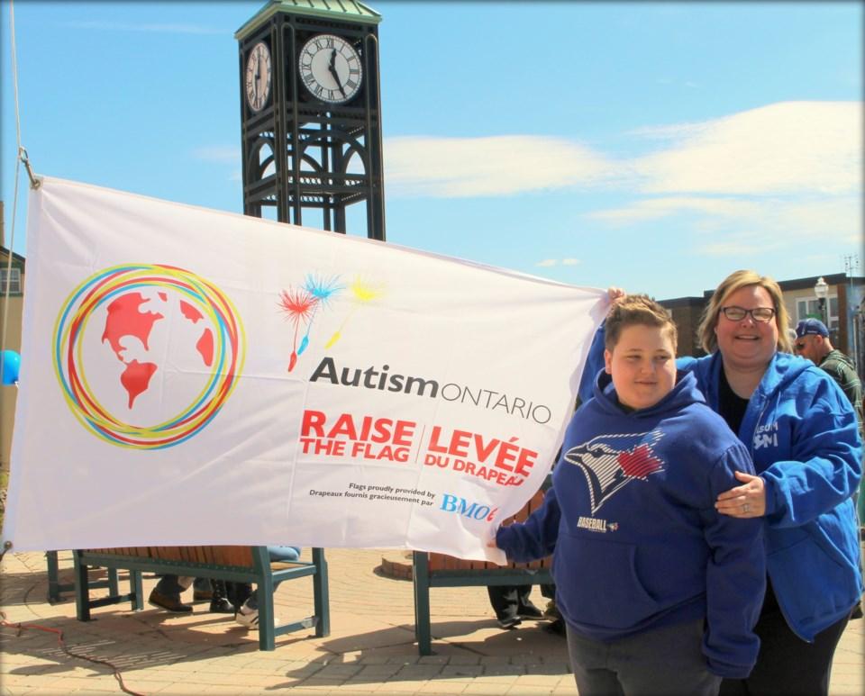 2019-03-20-autism flag raising