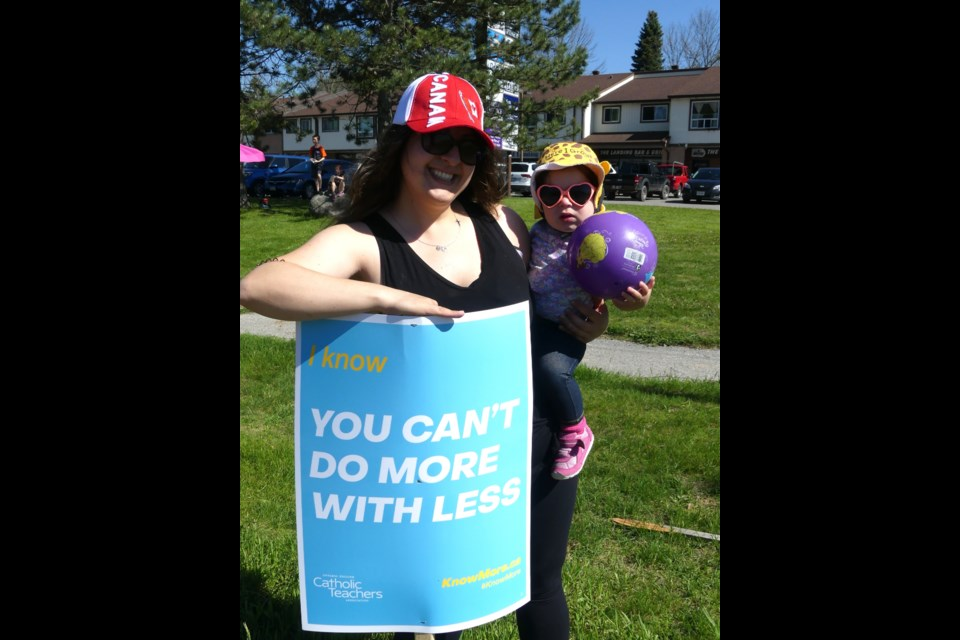 Protesting Newmarket teacher Christina Sottile, and her one- year-old daughter, Carina. Jenni Dunning/BradfordToday