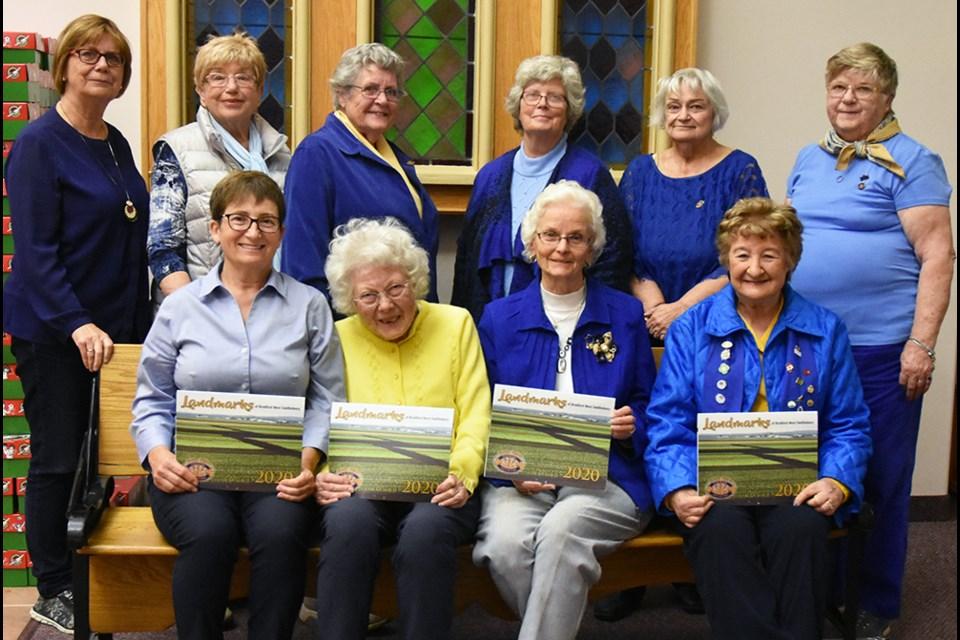 Members of the Bond Head Women's Institute with their fundraising calendar on the landmarks of Bradford West Gwillimbury. Miriam King/Bradford Today