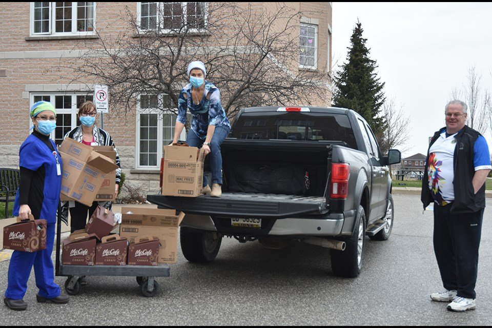 Bradford Lions Jamie Jones, at right, delivers the first consignment of coffee and treats for staff and care workers at Bradford Valley Care Community on Easter Sunday. Miriam King/Bradford Today