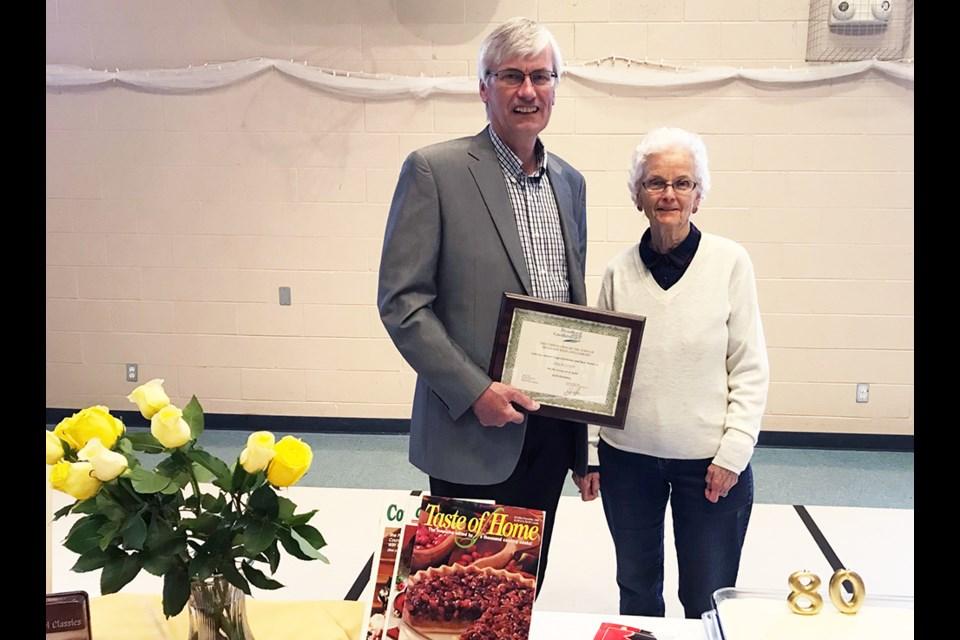 Bradford West Gwillimbury Mayor Rob Keffer presents a certificate congratulating Leila Lloyd on her 80th Birthday. Submitted photo