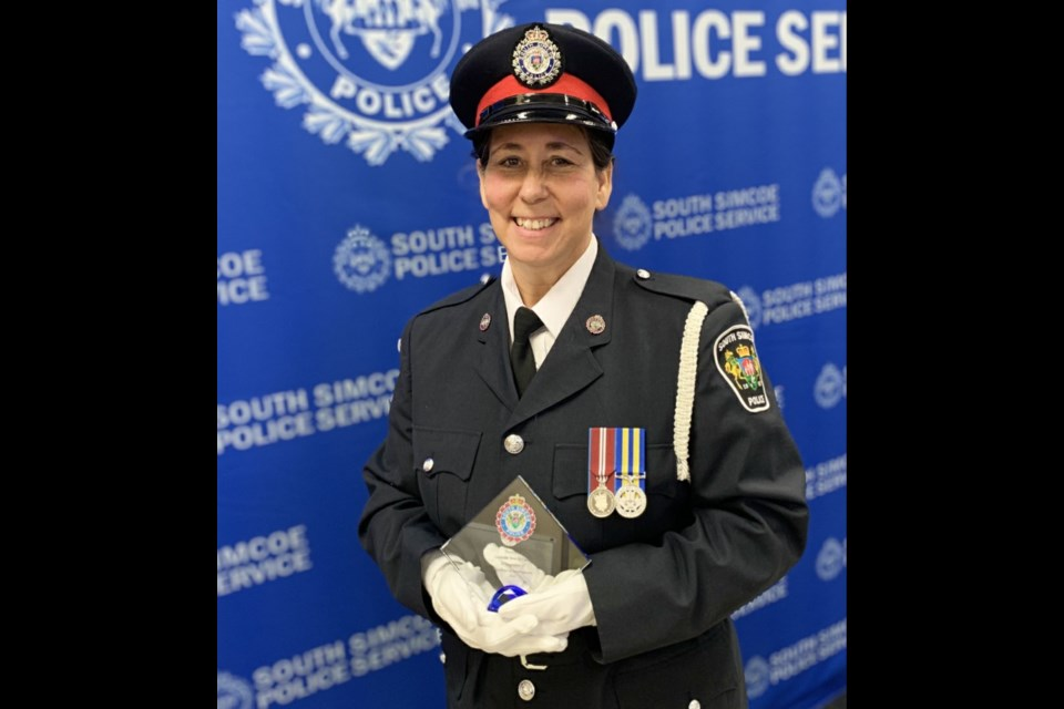 PC Terri McCullum receives her award for her investigative work on a donut shop robbery case in Bradford. SSPS photo.
