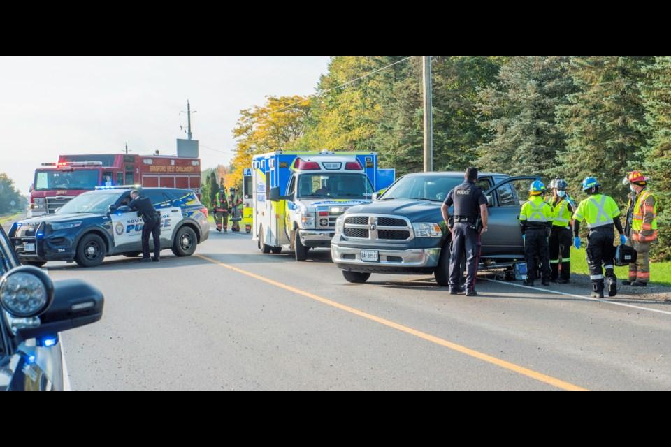 Emergency crews assess the driver of a pickup truck Sunday morning on 10 Sideroad at Line 11. Paul Novosad for BradfordToday