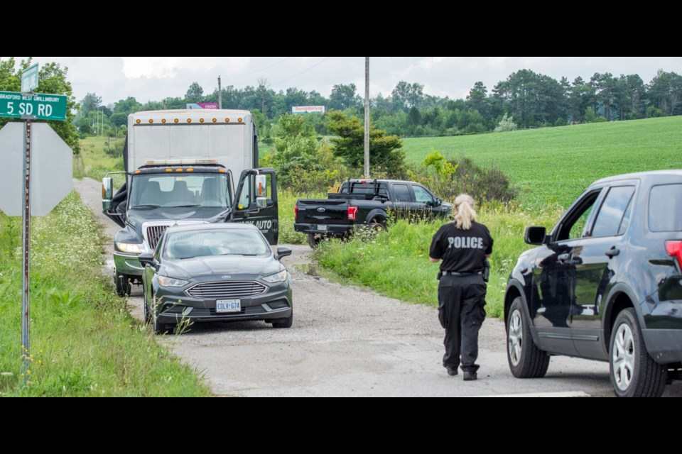 In a field at the 5th Sideroad and 10th Line in Bradford West Gwillimbury, OPP and York Regional Police recovered the black Ford F150 pickup truck linked to a shooting in Vaughan Aug. 2. Paul Novosad for BradfordToday