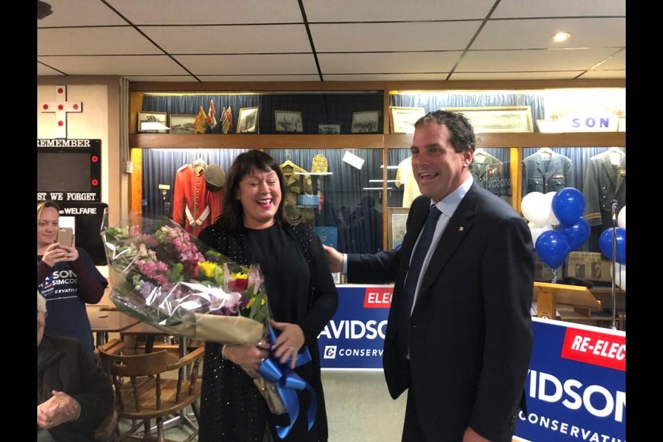 Scot Davidson thanks wife Suzanne with a bouquet of flowers. Natasha Philpott/BradfordToday