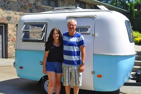 Emily Hunter and her father Stewart Hunter pose in front of their family '72 boler trailer after months of upgrades and renovations. Jackie Kozak/BradfordToday