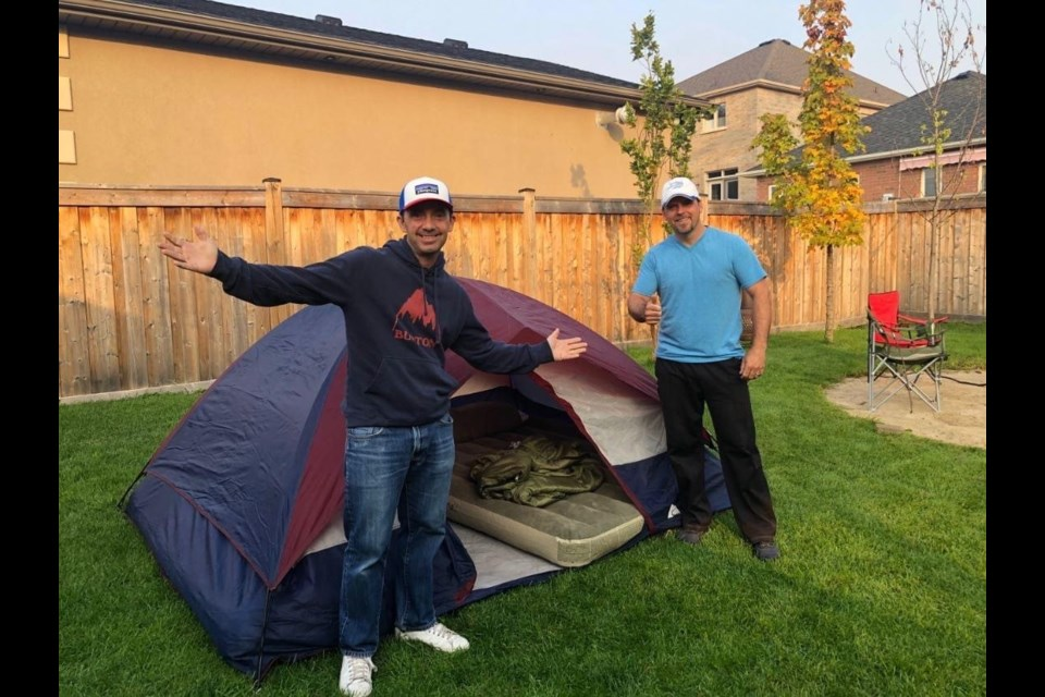Virtual hosts and celebrity campers, Peter Ferragine (Right: Ward 5 Councillor) and cousin Frank Ferragine (Frankie's Flowers) camped out in Peter's backyard in support of the fundraiser 'Roughin' it for a Reason' in support of the new Nature Centre in Scanlon Creek. /Photo Submitted.
