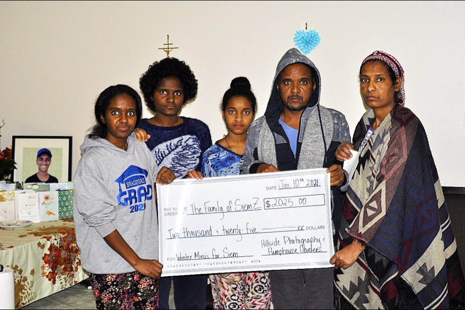 The Zerezghi family received a cheque for $2,025 from Hillside Photography (owner Cassidy Hilliard) as a supportive donation after the family lost their only son, Siem, who tragically died last October at the age of 15.