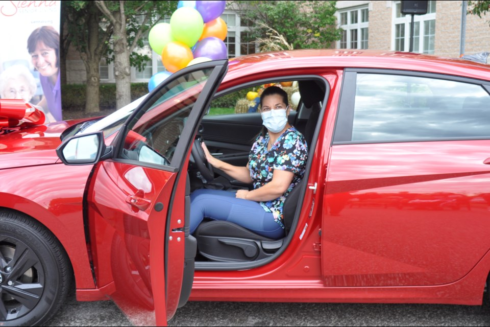 Bradford Valley PSW Sonia Botas won the grand prize 2021 Hyundai Elantra from a vaccination contest run by Sienna Senior Living and in partnership with Raptors Superfan Nav Bhatia who owns the Mississauga Hyundai dealership and runs the Raptors Superfan Foundation.