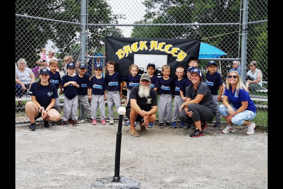 Tball Back Alley Cruisers with the Sponsor Gord Houston. Submitted Photo.