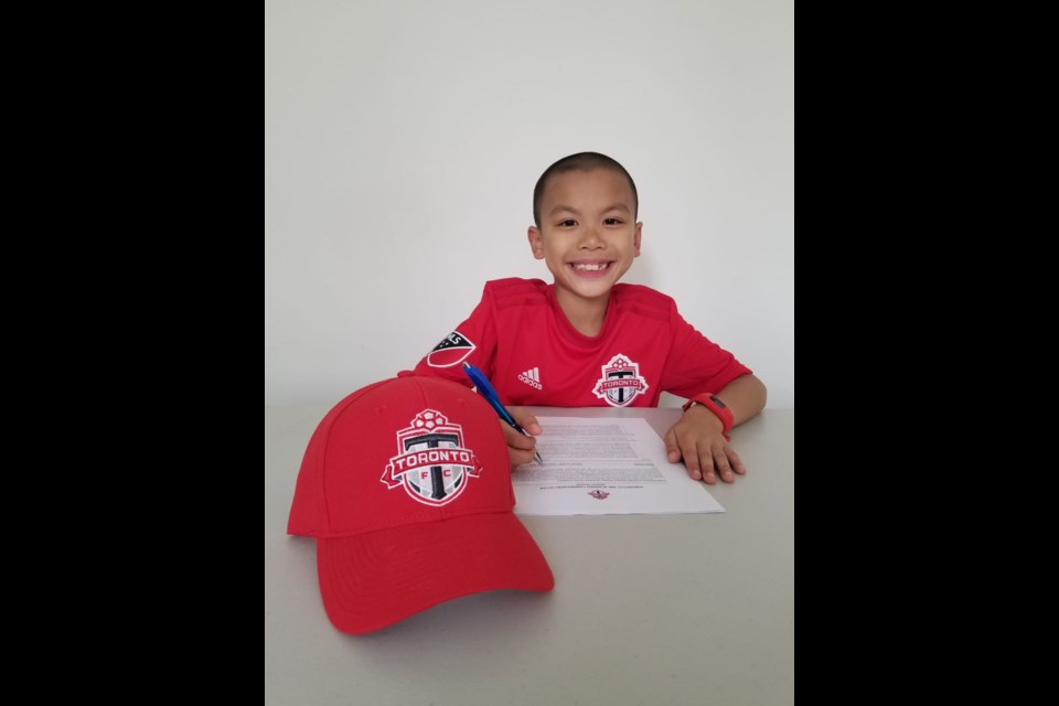 Eight-year-old Silas Leung recently signed a contract with TFC Juniors. Submitted