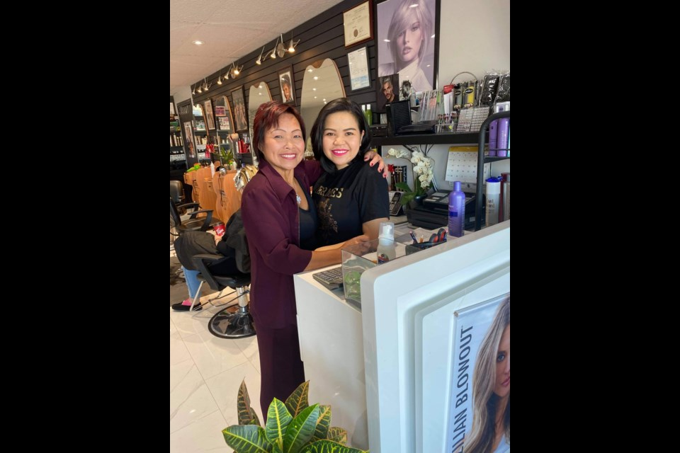 Tina Hart (left) with her niece Lina Kim at the Tina's Friendly Hair Salon in Bradford.