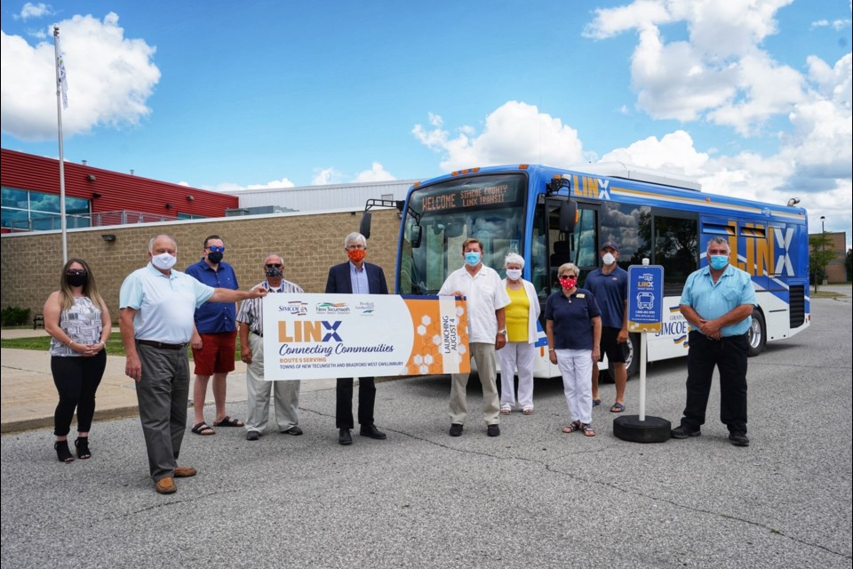 County of Simcoe Warden George Connell and LINX Transit staff join Politicians from both New Tecumseth and Bradford West Gwillimbury in launching new bus route. SUBMITTED