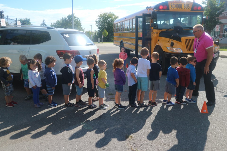 Simcoe County Student Transportation Consortium's Sean Levasseur leads the group of students on their first school bus ride. Natasha Philpott/BradfordToday