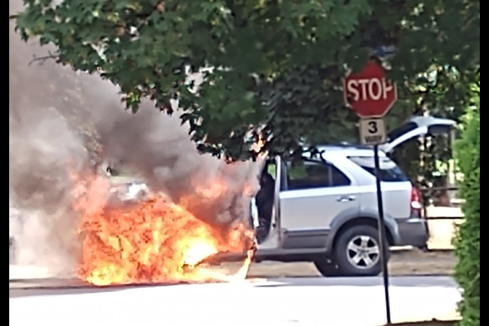 A vehicle on fire near Queen's Park.