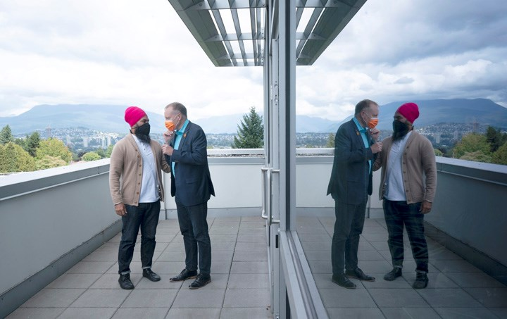 New Democratic leader Jagmeet Singh speaks with New West-Burnaby MP Peter Julian. THE CANADIAN PRESS/Adrian Wyld