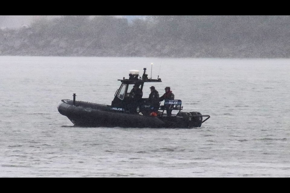 A police boat was used to recover a body on Friday.