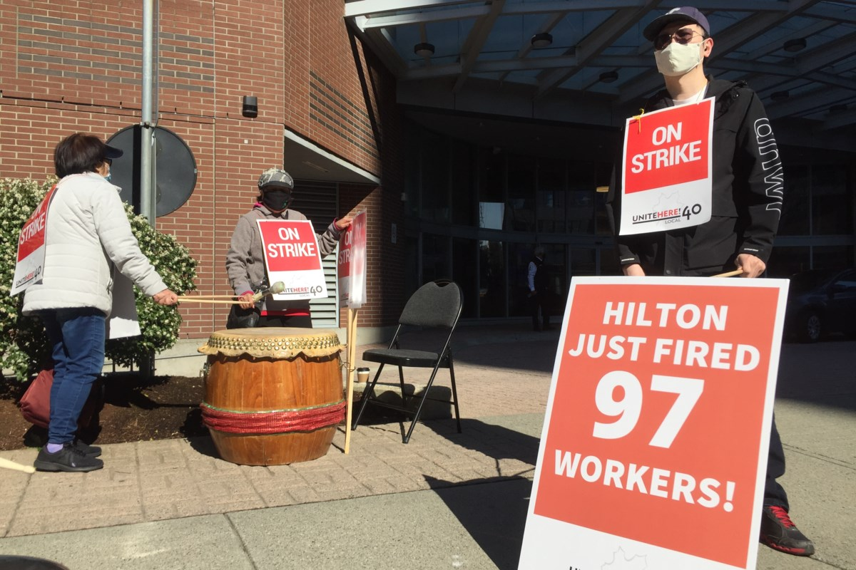 Burnaby hotel workers walk off job in one-day strike action after 'mass firings'