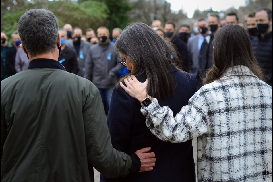 The family of Olivia Malcom – father Tony, mother Bridget and sister Erica – are met by supporters outside Surrey provincial court after the sentencing of the driver responsible for her death.