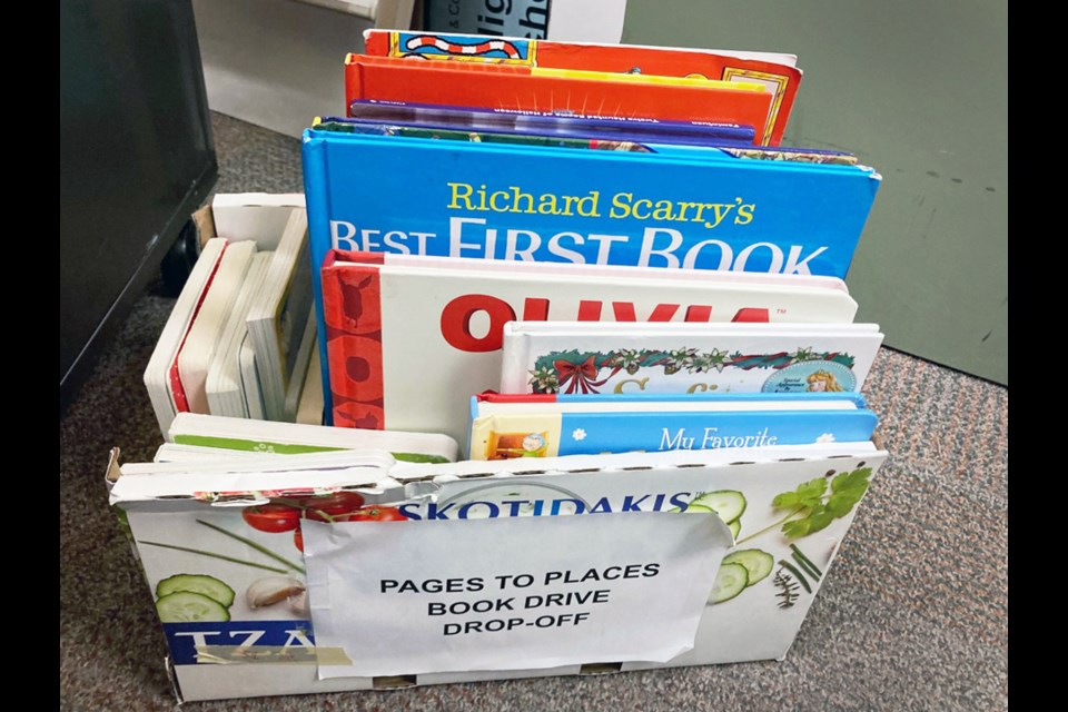 A Pages To Places book donation bin is stuffed with books that will be sent  to Vietnam.