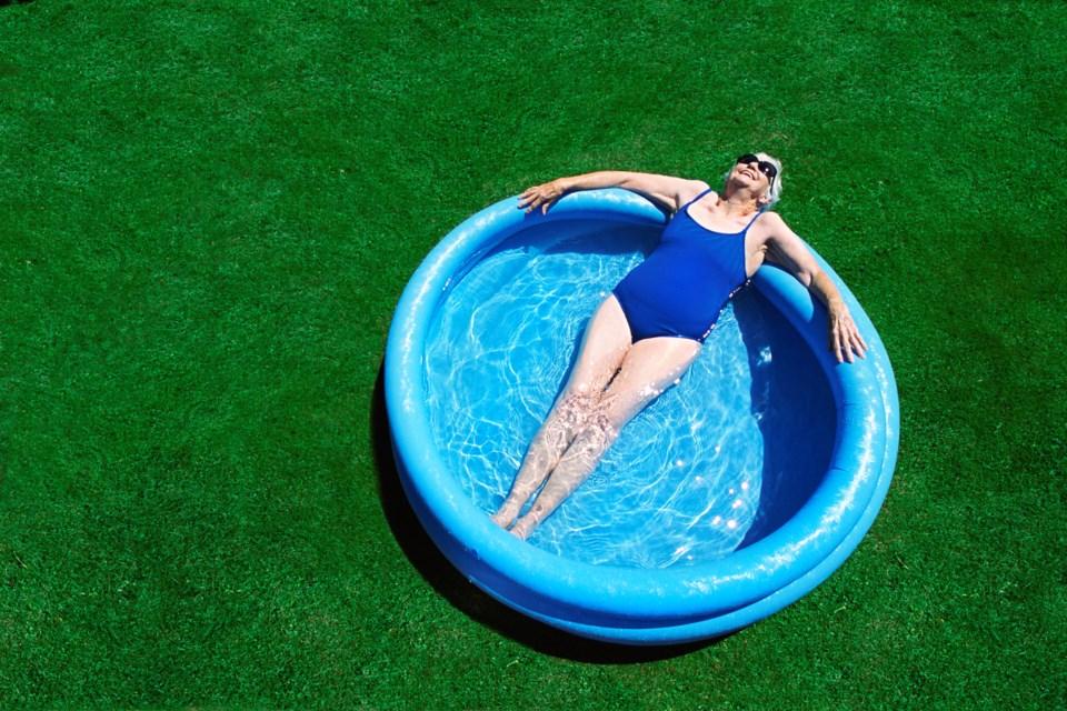 Adult in the Kiddie Pool Heat Wave