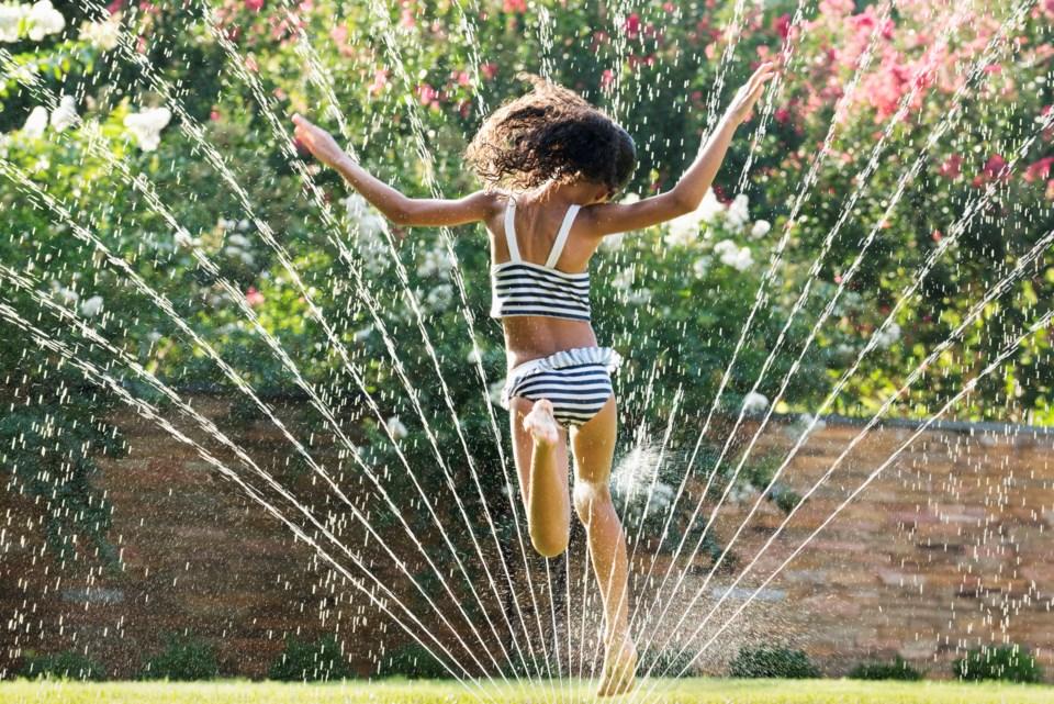 Heat wave child sprinkler