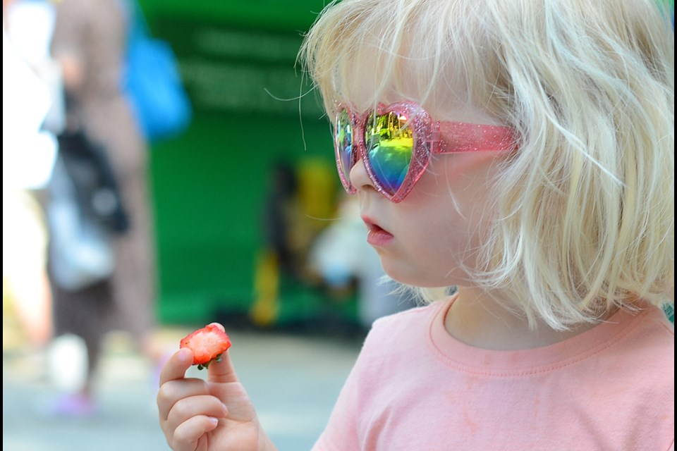 Eva Owen, 3, samples some of the wares at the June 3 New West Farmers Market.