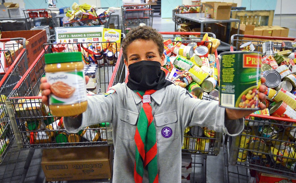 Adam Mohamed, 10, and his Burnaby Lake Jamatkhana cub scout troop collected 250 food items and $150 in cash for the Ismaili CIVIC Ramadan Food Drive.