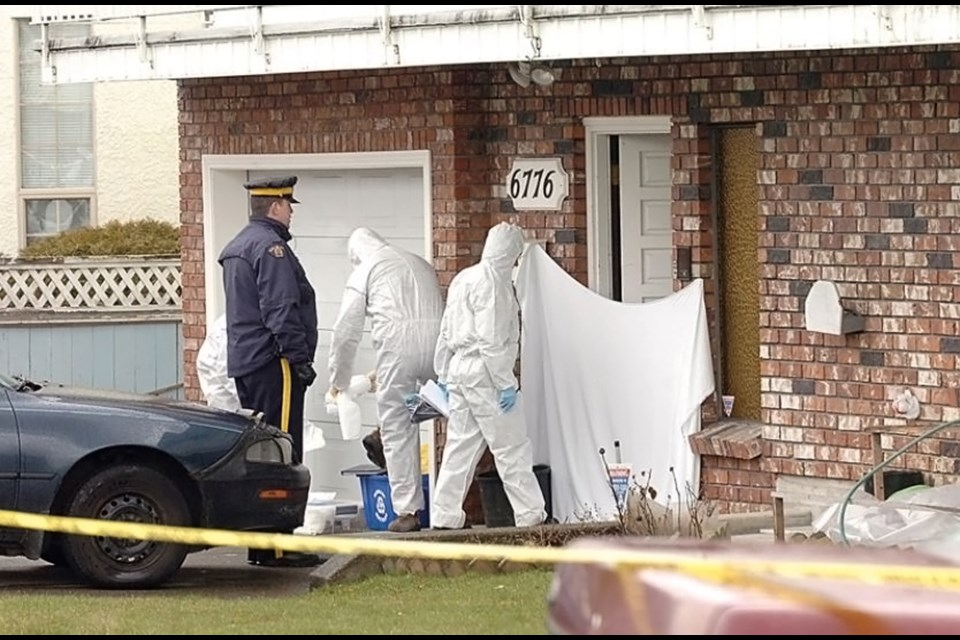 Homicide investigators scour a unit in a Colborne Avenue fourplex in March 2009 after the discovery of Kimberly Halgarth's body inside.