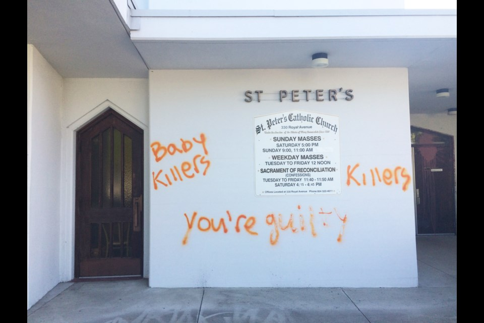 St. Peter's Roman Catholic Church, at Royal and Fourth, was hit by orange spraypainted graffiti and splattered paint over the weekend, in a clear reference to the ongoing discovery of unmarked graves at residential schools.