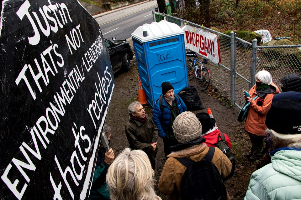 Yvon Raoul (left) and Earle Peach address their supporters after receiving $150 fines for trespassing on CN Rail property in protest against the Trans Mountain pipeline expansion on Dec. 10, 2020. Photo via Dustin Godfrey/Burnaby Now