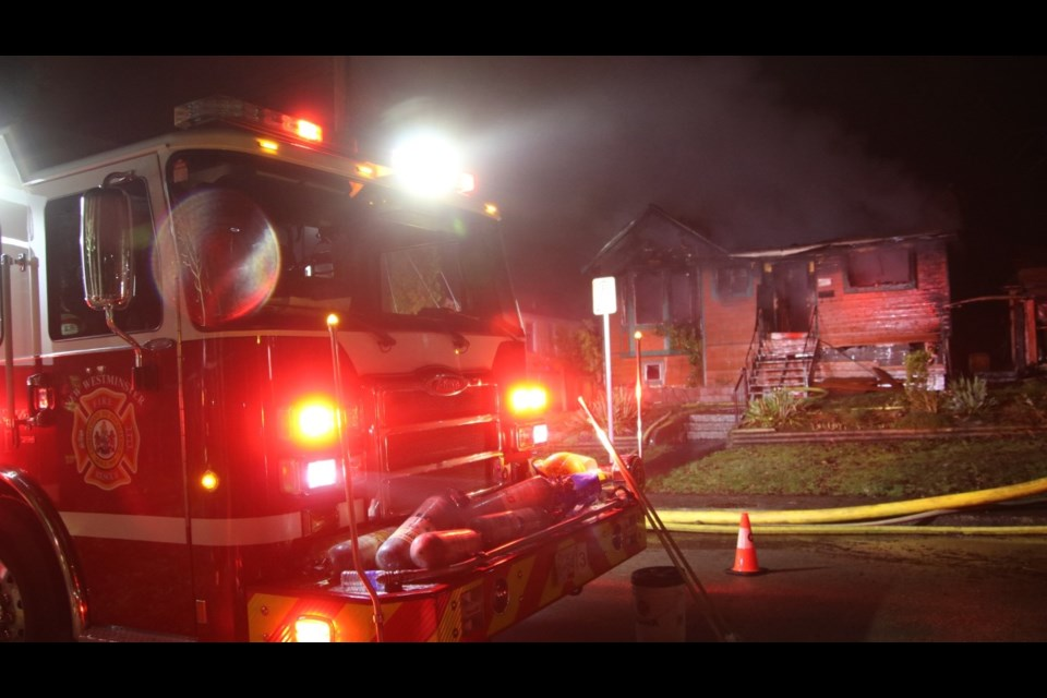 Flames were shooting out of the roof and windows when New Westminster firefighters arrived at this Wilson Street residence about 3 a.m. on Monday, Jan. 18. The house, which had been abandoned, will be demolished and searched to ensure it was unoccupied at the time of the fire.