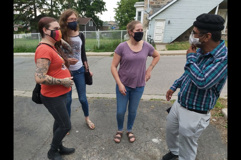 Athena Van Nacht, Lilith Kummling, and Courtney Winkels were walking back home from work when they stopped in at the open house to chat with Nomaan Mubashir, president of the mosque.