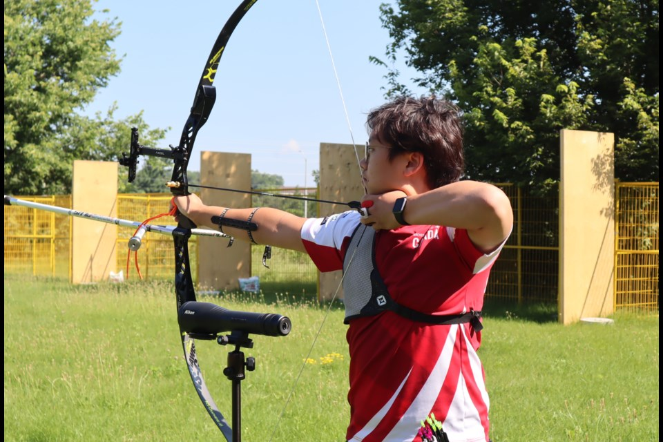 Junior national team archer Ben Lee, who leaves this week for the Youth World Archery Championships in Poland, takes in practice at the new Archery Canada range in Cambridge.