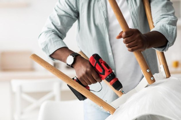furniture-assembly-process-african-american-handym-DW3YHN3