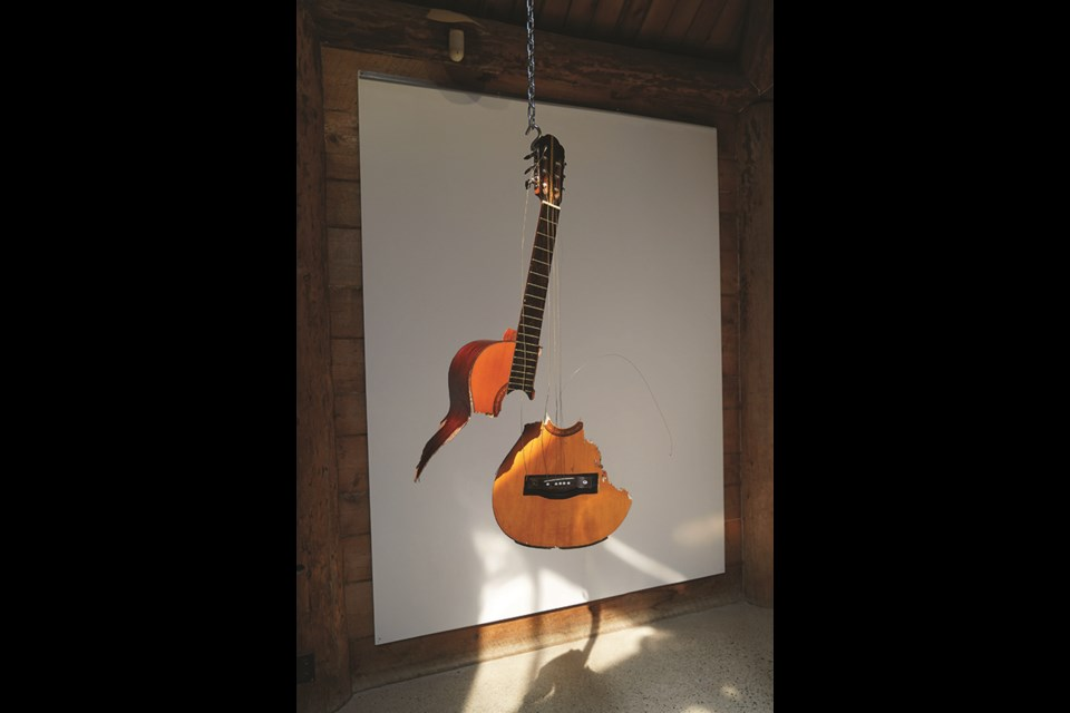 A broken guitar was among the discarded objects artist Pippa Lattey found on a Sunshine Coast sojourn in May.