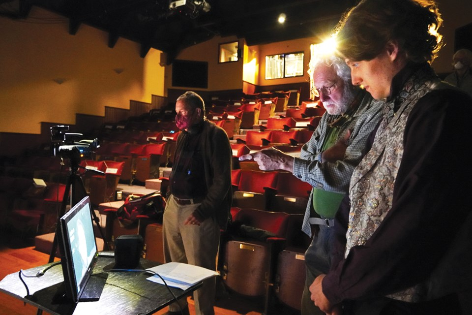 Videographer Murray Peterson, left, waits while director Mac Dodge and actor Gabe Ryan review one of Ryan's takes playing Walter Simmons in Spoon River.