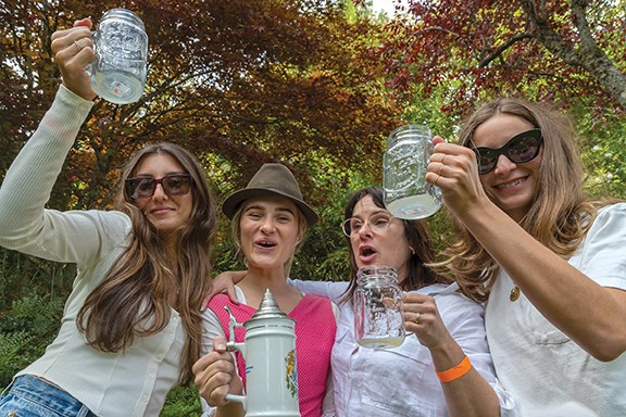 From left: Lea Faradian, Adelie Houle-LaChance, Renee Lachance and Coralie Kourany raise a glass at Oktoberfest to celebrate Adelie's 30th birthday.