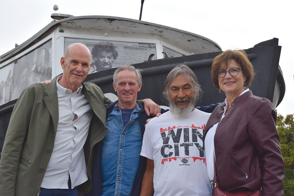 Four actors who got their start on The Beachcombers reunited on Sept. 16 for the show's 50th anniversary of filming in Gibsons. Left to right: Jackson Davies (Constable John Constable), Bob Park (Hughie Carmody), Pat John (Jesse Jim), and Nancy Chapple (the original Margaret Carmody) in front of the Persephone.