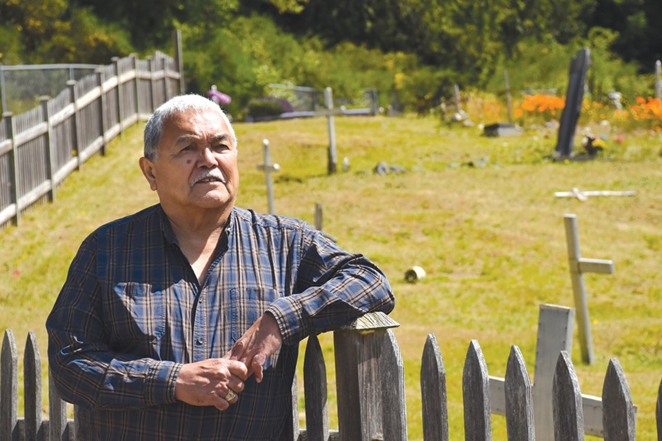 Hiwus (Chief) Warren Paull stands at the cemetery on shíshálh Nation lands, located near the now-closed Our Lady of Lourdes Mission Church. Students who died at Sechelt Residential School are buried at the cemetery.