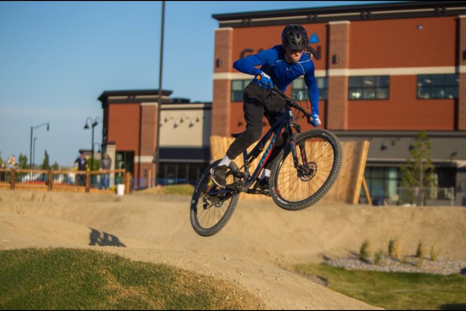 Sam Pickering, 15, takes on Cochrane's First Bike Park on Wednesday (Aug. 12). (Chelsea Kemp/The Cochrane Eagle)