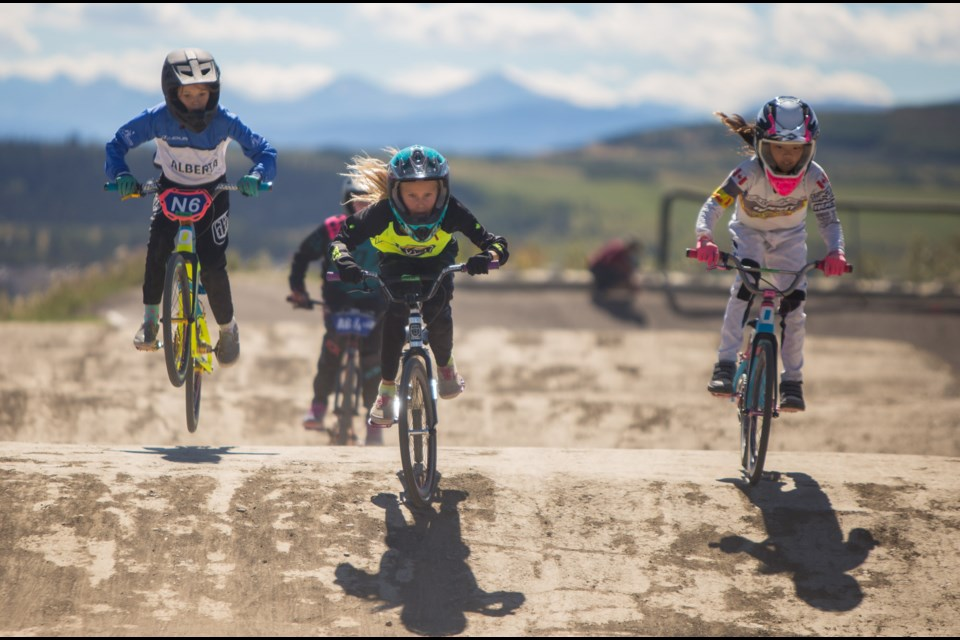 Racers attend the 2020 Nyhaug and Palmer BMX Camp at the Cochrane BMX Association on Saturday (Aug. 22). The two day camp features instructions from Olympic BMX racers Tory Nyhaug and James Palmer. (Chelsea Kemp/The Cochrane Eagle)