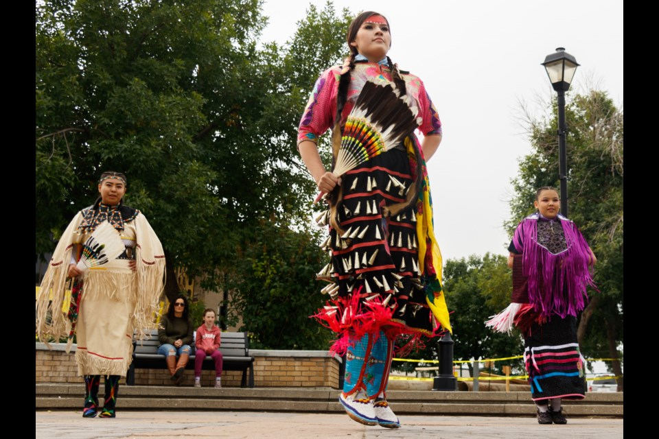 The Stoney Nakoda Mini Thni dancers perform at Centennial Plaza during Cochrane Culture Days on Sunday (Sept. 19). (Chelsea Kemp/The Cochrane Eagle)