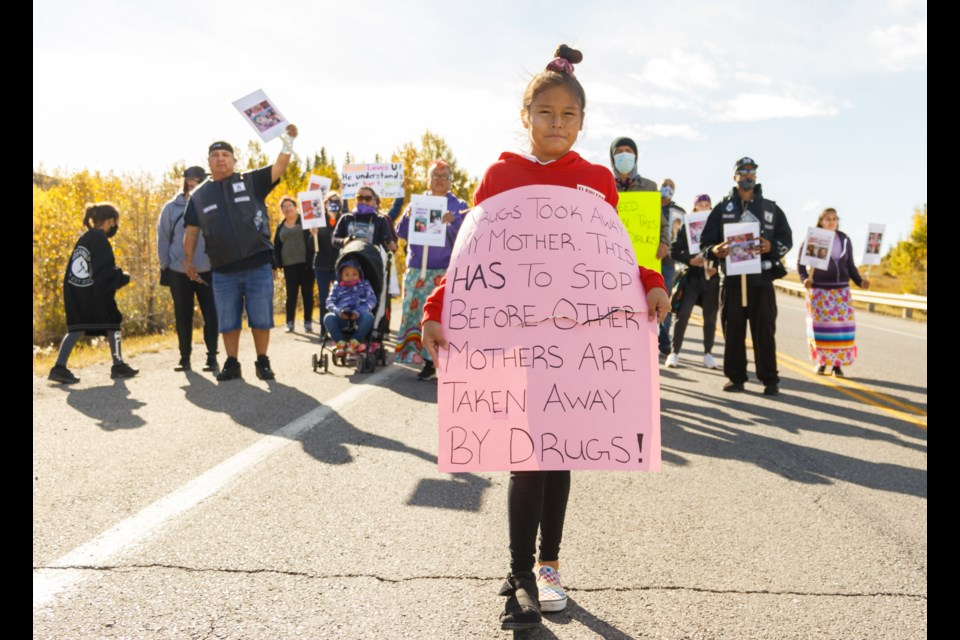 Kallie Powder leads ralliers down Morley Road during the Addictions Awareness Walk in Stoney Nakoda First Nation on Saturday (Sept. 26). (Chelsea Kemp/The Cochrane Eagle)