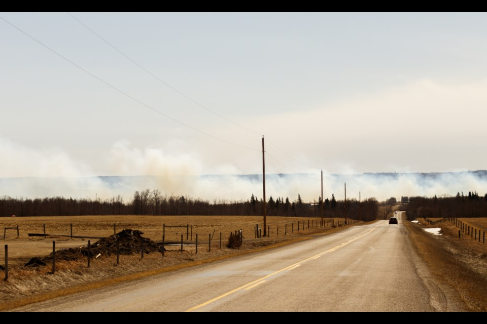 A wile fire rages between the Ghost Station Gas Bar and Wild Cat Gas Plant on Thursday (April 1). (Chelsea Kemp/The Cochrane Eagle)